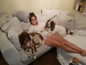 Alice Dartnell Life Success Coach London Consultation working at home with Cocker Spaniel dogs on sofa