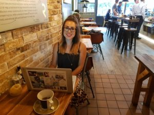Alice Dartnell Life Success Coach London Consultation Ravello Café in Surrey updating blog & prepearing coaching session
