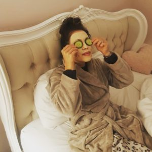 Alice Dartnell Life Success Coach Consultation London laying on bed me time eye mask cucumber facial