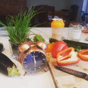 Alice Dartnell Life Success Coach Arbonne Clock on counter in Offce kitchen in London England