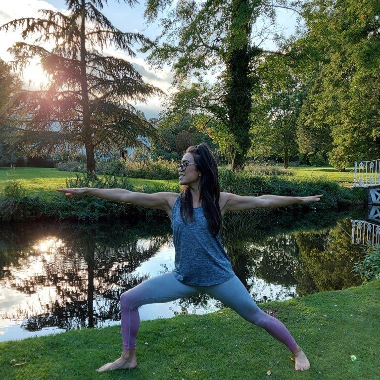 Alice Dartnell London Life Coach in park doing yoga warrior pose