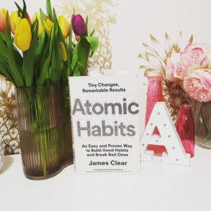 Alice Dartnell Life Success Coach  London Consultation  reading James Clear Atomic Habits in Grand Park Royal Hotal Cancun Mexico