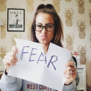 Alice Dartnell Life Success Coach London UK holding up her Fear Failure self-talk sign