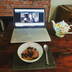 Alice Dartnell Life Success Coach laptop learing Japanese on her laptop while having breakfast teapot on lombok wooden table